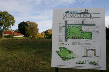 A sign depicts plans for Pleasant Park at Madison Avenue and Pleasant Street SE. To help fund construction of the park, Grand Rapids City Commission has approved a $500 special assessment on about 400 nearby properties.