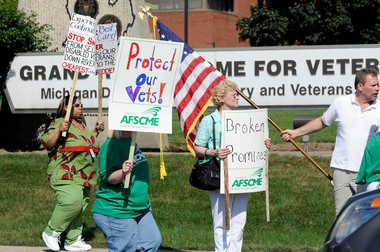 Caregivers and residents protest at the Grand Rapids Home for Veterans in July 2011 against a plan to privatize 170 positions at the home.