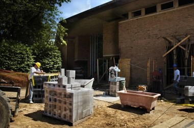 In this 2009 photo, construction workers build the wall of Calvin College's Fine Arts Center.