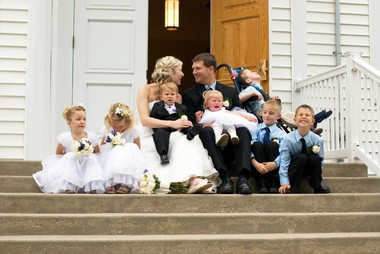 Jessica and Ryan Ronne and their kids on their official church wedding day in May 28, 2011. The couple had legally married in a courthouse ceremony in April, before combining their two households into one. They held the church wedding so the children could take part.
