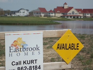 Grand Rapids-based Eastbrook homes is building homes and condominiums on long-vacant lots in the Macatawa Legends development along the lakeshore.