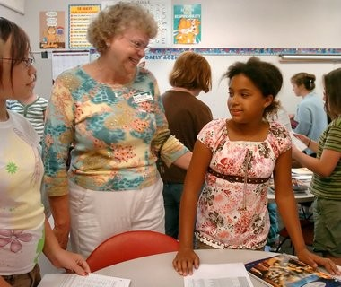 In this file photo, Black River Public School teacher Marcia Windemuller greets incoming 6th grader Emma Swanson , 11, during orientation at the Holland school.