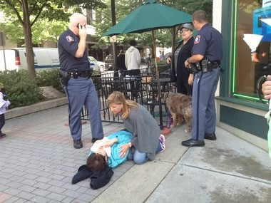 Evelyn Searl, 75, of Grand Rapids is aided by passers-by after falling during an alleged purse-snatching on Tuesday, Sept. 17.