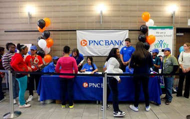 Alger Middle School students open bank accounts at their in-school bank in the school cafeteria. PNC Bank and United Way teamed up with Grand Rapids Public Schools to start the bank, which is the second of its kind in the state. Another bank will open Wednesday, Oct. 30, at Martin Luther King Leadership Academy.