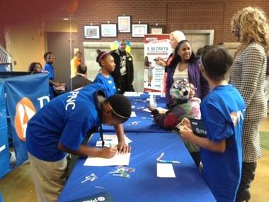 MLK bank tellers register fellow classmates for savings accounts.