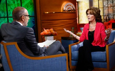 """This image released by NBC shows co-host Matt Lauer, left, listening to former Alaska Gov. Sarah Palin during an appearance on NBC News' """"Today"""" show, Monday, Nov. 11, 2013, in New York. Palin was on the show to promote her new holiday book, """"Good Tidings and Great Joy: Protecting the Heart of Christmas."""""""