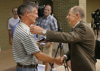 Don Davis, right, is shown greeting Marvin Dietz, the brother of the missing and presumed dead, Donald Dietz, after the government earned a conviction against Rami Saba in the case. Davis is retiring after a 40-year career in the U.S. Attorney's office, including a four-year stint that he led the Grand Rapids-based office.