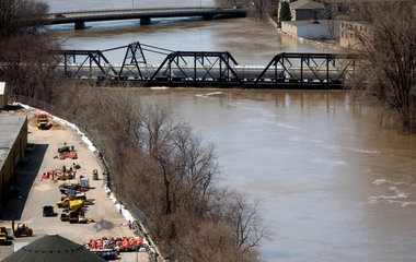 The CSX train trestle near Wealthy Street was loaded down with salt-filled cars during the 2013 Flood to weigh down the 110-year-old structure.