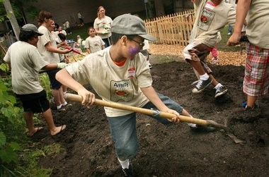 File photo of Grand Rapids students shoveling dirt community garden to help educate youth about nutrition, organic gardening and cooking at the Steil Boys & Girls Club on Straight Avenue in 2010. The Boys & Girls Club and GRPS have a partnership this year with Dean Transportation to help increase attendance.