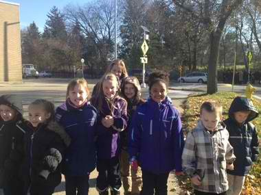 Photo of Palmer Elementary students heading back to class after a Nov. 14, 2013 ribbon cutting for a new pedestrian refuge island and school crosswalk at the intersection of Plainfield Avenue and Palmer. One of several safety improvements through the Safe Routes to School program.