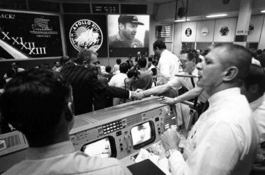 """Gene Kranz, right, celebrated the Apollo 13 splashdown at Johnson Space Center's Mission Control in Houston on April 17, 1970. Kranz, leader of the """"Tiger Team"""" of flight directors, who brought the Apollo 13 spaceship safely back to Earth, and Captain James Lovell, the astronaut in command, are the keynote speakers for the 2014 West Michigan Aviation Academy's Leaders of Tomorrow Gala on May 22."""