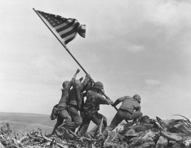 U.S. Marines of the 28th Regiment of the Fifth Division raise the American flag atop Mt. Suribachi, Iwo Jima, on Feb. 23, 1945, in this Pulitzer Prize-winning photo by Joe Rosenthal.