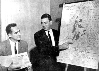 Grand Rapids city planners Keith Honey, left, and Howell Gilbert, right, with a map showing neighborhood areas around Grand Rapids that 1950s planners saw as deteriorating.