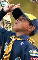 A boy scout salutes the U.S. flag on Sept. 11, 2012.