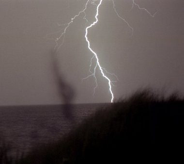 A lightning bolt flashes over Lake Michigan as a storm moves over the water in this file photo.