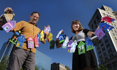 Paul Haan and Kelly Malinowsi from the Healthy Homes Coalition of West Michigan strung 1,000 little foam houses at Rosa Parks Circle last summer to celebrate removing lead hazards from 1,000-plus Grand Rapids residences.