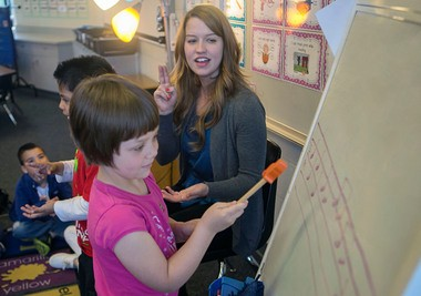Mine Meets Music Master Teaching Artist Erin VanDellen works with students at Wyoming's Parkview Elementary.