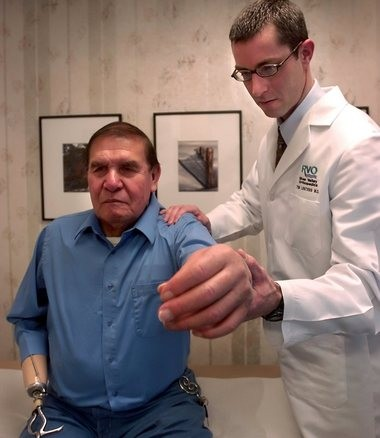 Dr. Tim Lenters examines Simon Francis after his reverse shoulder replacement surgery in this 2006 file photo.