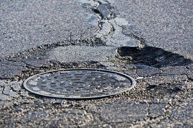 A pothole along Michigan Avenue NE in Grand Rapids, Mich., Thursday, Feb. 27, 2014.