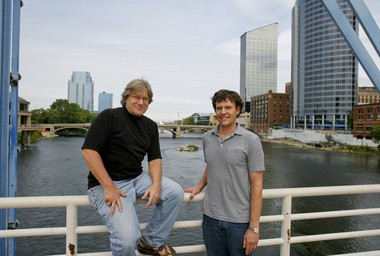 Chip Richards, left, and Chris Muller are organizers of an effort to remove Grand River dams through downtown Grand Rapids and restore the water's rapids. The idea has attracted state and federal support, and is influencing the city's plans for flood protection.