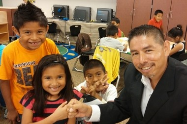 Roberto Torres, recently named the new executive director of the Hispanic Center of West Michigan, spends time with children. He is the former executive director of the Northwest Ohio Chamber of Commerce.