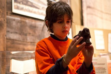 Mateo Pava looks at a historical artifact at the Grand Rapids Public Museum on Nov. 14, 2013, when his class from Grand Rapids Montessori Public School visited for a week as part of the Immerse program.