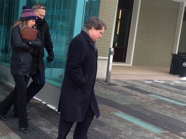 Former Kentwood Pharmacy CEO Kim Mulder leaves U.S. District Court in Grand Rapids on Friday, Feb. 20, flanked by attorneys, Britt Cobb, left, and Charles Chamberlain Jr., right.