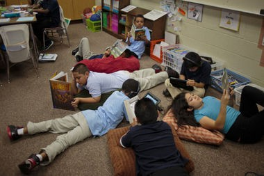 Fourth grade students lounge as they read at Buchanan Elementary, Grand Rapids, Mich., September 24, 2014.