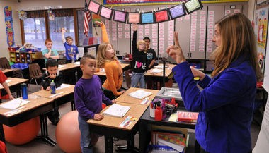 West Ottawa's Lakeshore Elementary third grade teacher Laura Keith conducts a math lesson on Nov. 25, 2014. Lakeshore is one of five West Michigan schools involved in a Reading Now Network study