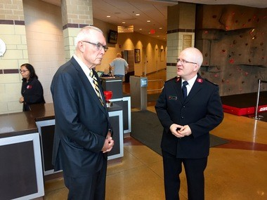 Gen. Barry McCaffrey, left, speaks with Major Marc Johnson, senior officer for The Salvation Army Kroc Center, prior to the general's start of the tour Thursday, May 14, 2015.