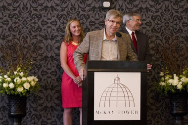 Jonathan L. Borisch speaks during the McKay Tower ballroom grand opening. Behind him is daughter Chaundra Derks, the property manager, and Grand Rapids Mayor George Heartwell.