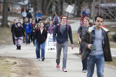 Students walk on campus at Calvin College. Calvin was one of 22 Michigan colleges to be awarded a state grant for sexual assault prevention strategies.