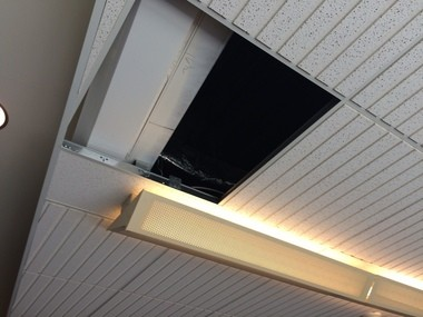 A ceiling tile is missing on the second-floor of the Kent County Courthouse after a woman climbed into scaffolding above the tiles on Thursday, July 28