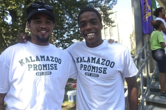 Kalamazoo Promise Scholars Joe Boggan, and Tinashe Chaponda celebrate in Bronson Park. The 10th anniversary celebration for The Kalamazoo Promise was held in Bronson Park and had everything from a free concerts, to a free raffle, to a free hot dog lunch provided by Costco. (Daytona Niles/Kalamazoo Gazette)