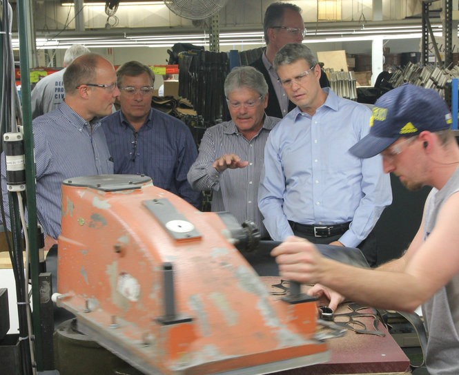 On May 28, 2015, at the invitation of Wolverine World Wide, Inc. CEO Blake Kreuger, Representative John Moolenaar and Representative Bill Huizenga visited and toured Wolverine's manufacturing facility in Big Rapids, one of the few remaining footwear manufacturing facilities in the United States. (Courtesy | Wolverine Worldwide)
