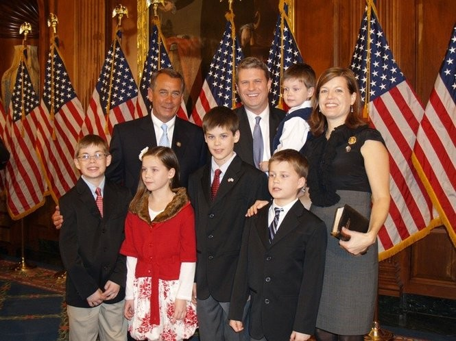 U.S. Rep. Bill Huizenga, R-Zeeland, with his wife, Natalie, and their five children after his 2012 swearing in with then House Speaker Leader John Boehner. (Courtesy photo)