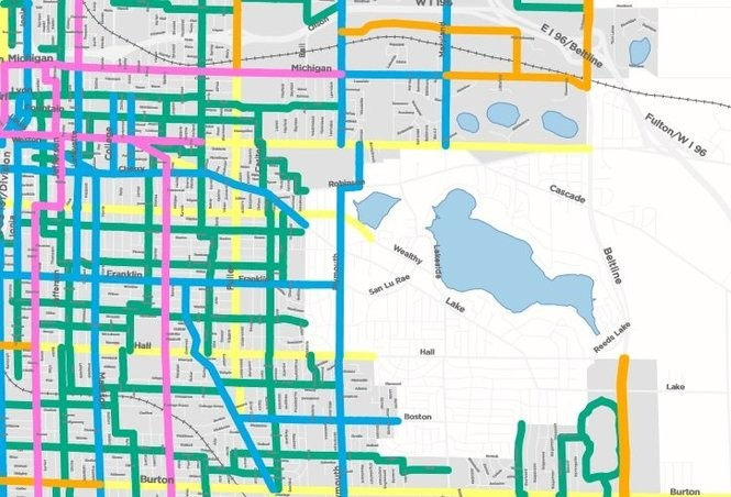 A graphic produced by the city of Grand Rapids' Vital Streets plan showing transit modes identified for major streets southeast of downtown. Commuter bicycle routes are shown in blue, community bike routes are in green, transit routes for buses and streetcars are in pink, vehicle-only routes are in gold and blended routes are in light yellow. (Courtesy | City of Grand Rapids)