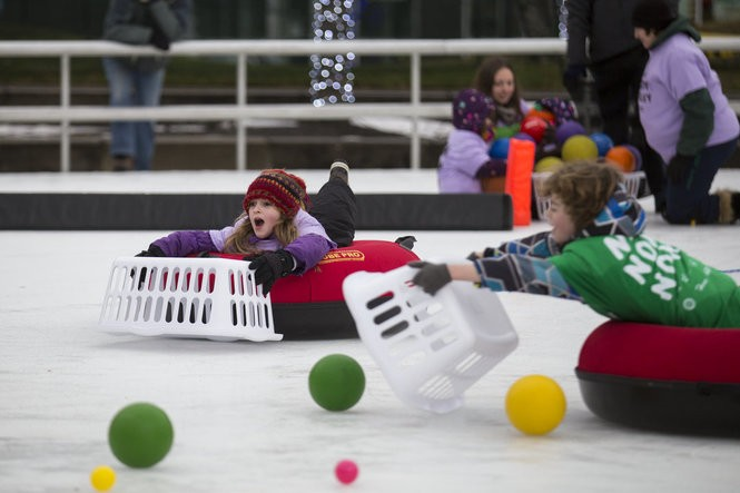 Annabelle Pake, 8, and William Selleck, 8, play Human Hungry Hungry Hippos on the skating rink at Rosa Parks Circle in Grand Rapids on Sunday, Feb. 12, 2017. The event attracted about 200 competitors and was hosted by the Grand Rapids Sport & Social Club as part of Snow Days.