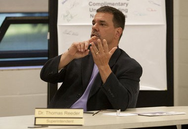 Wyoming Superintendent Thomas Reeder speaks to community members during a special school board meeting after voters defeated a second tax request in 2013.