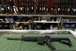 In this July 26, 2012 file photo an AR-15 style rifle is displayed at the Firing-Line indoor range and gun shop, in Aurora, Colorado.