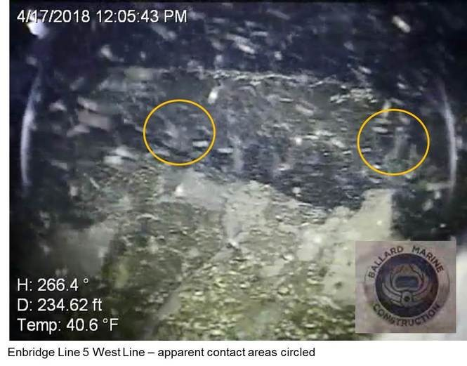 "An underwater photograph of Enbridge Line 5's western leg shows what the company calls ""apparent contact areas,"" which are circled, believed to be damage resulting from an April 1 incident in the Straits of Mackinac."