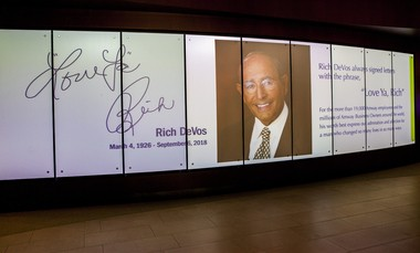 Rich DeVos is memorialized on a digital display in the lobby of Amway's headquarters in Ada Township on Thursday, Sept. 6, 2018. DeVos, the co-founder of Amway Corp., died Thursday.