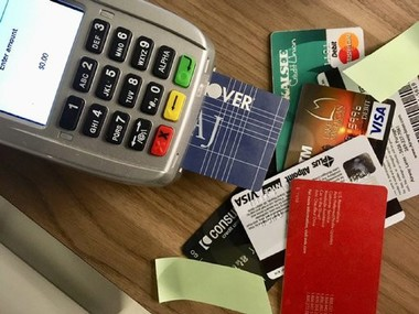 The government said a group used stolen mail to obtain credit-card information to rack up nearly $400,000 in purchases, including gift cards.