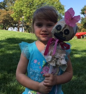 Kisara VanderStel, 4, holds the puppet she made during Head Start for Kent County's visit to ArtPrize Friday, Sept. 22.