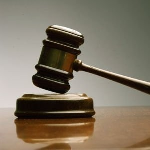 A Lansing man linked to a national drug ring was sentenced to prison this week in u.S. District Court in Grand Rapids.
