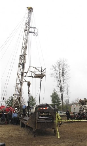 In this May 19, 2011 photo, crews prepare to pump water and chemicals into a natural gas well in Charlton Township.
