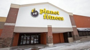 Police say an FBI special agent fired at a Grand Rapids police officer outside of a Planet Fitness center.