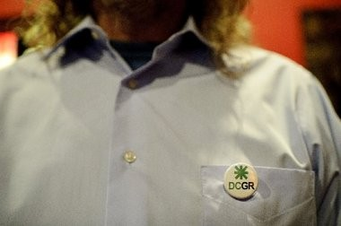 A supporter of Grand Rapids Proposal 2 (the decriminalization of marijuana) wears a button to show his support during the watch party at The Meanwhile Bar on Tuesday, November 6, 2012.