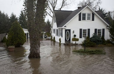 Homes partially underwater on White St. SW, on Friday, April 19, 2013, in Grandville, Mich.