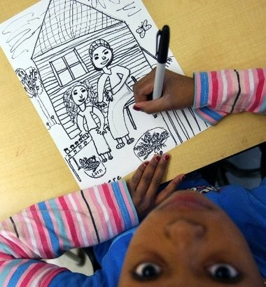 Sincere Johnson, 9, works on a drawing during Sharon Maddox's art class at Grand Rapids' Dickinson Elementary School in 2011.